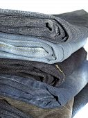 Denim trousers arranged one on second , poster