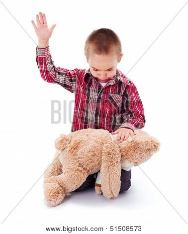 Angry little kid beating his teddy bear - domestic abuse concept poster