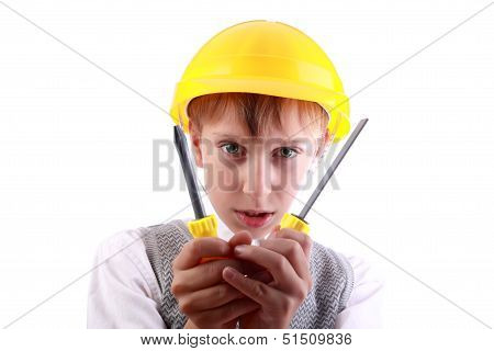 Beautiful cheerful blond boy as a construction worker wearing a yellow hard hat and colorful tools