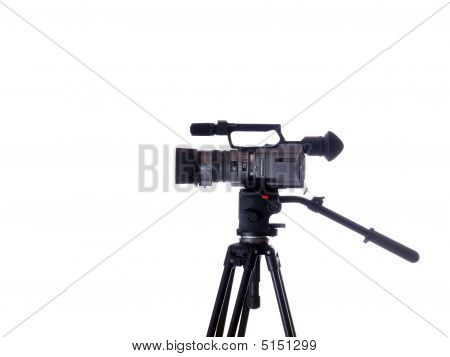 Side View Of Mid-priced Video Camera On Tripod