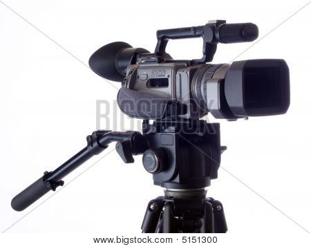 Black Video Camera Mounted On Tripod Against White