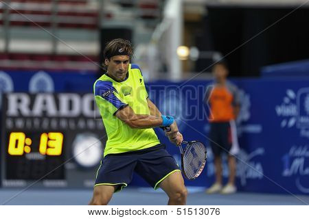 KUALA LUMPUR - SEPTEMBER 27: David Ferrer plays a return to Joao Sousa in a quarter-final match of the Malaysia Open 2013 tennis played at the Putra Stadium, Malaysia on September 27, 2013.