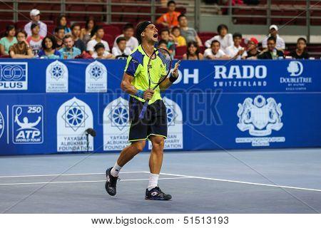 KUALA LUMPUR - SEPTEMBER 27: David Ferrer reacts during a quarter-final match playing Joao Sousa at the Malaysia Open 2013 tennis played at the Putra Stadium, Malaysia on September 27, 2013.
