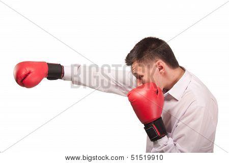 Bisinessman wearing boxing gloves