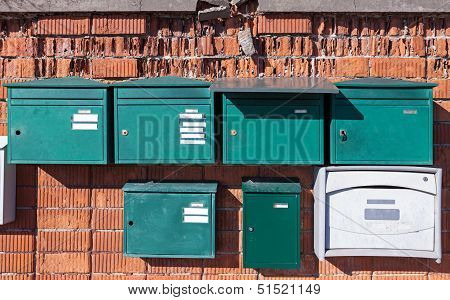 Green European Metal Post Boxes On Old Brick Wall