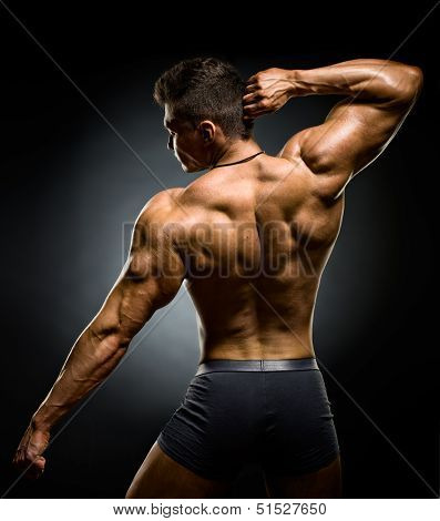 poster of the very muscular back of a bodybuilder