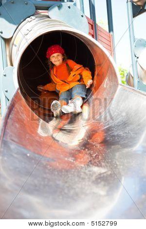 Little Girl In Playground Tube