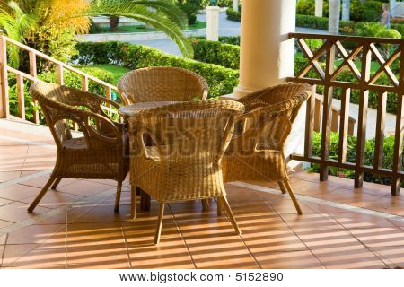 Table And Four Chairs On Patio