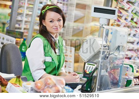 Portrait of Sales assistant or cashdesk worker in supermarket store