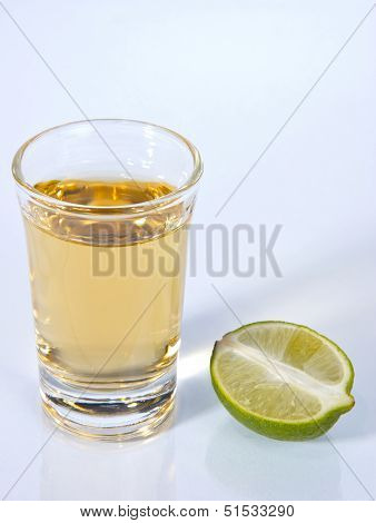 Tequila Shot With Half Green Lime