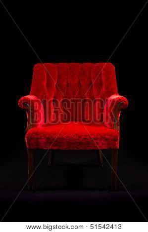 Red Velvet Chair On Black Background