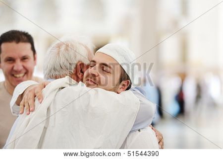 Muslim Arabic brothers meeting together with father
