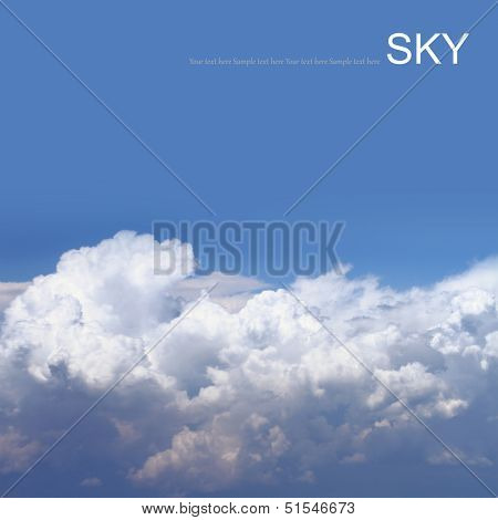 Blue sky with clouds, air shot.