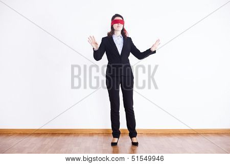 blindfold businesswoman trying to find something