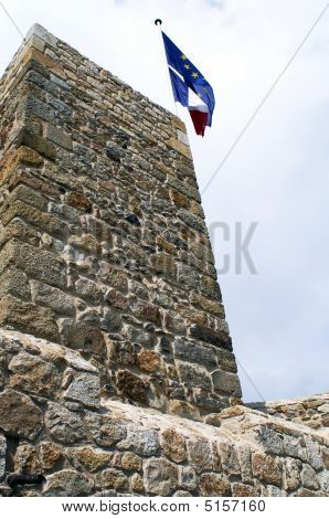 Old Castle Tower With Two Flags