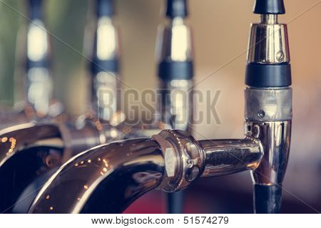 Beer taps close up in a pub