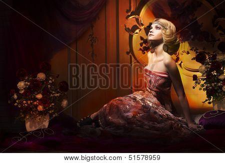 Splendor. Aristocratic Woman In Luxury Vintage Interior Looking Up