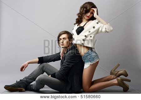 Young Affectionate Amorous Couple In Studio. Fondness