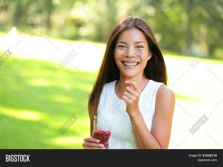 Woman Eating Goji Image Photo Free Trial Bigstock