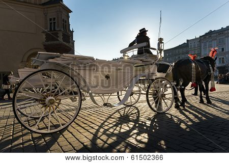 Hansom Cab Woman On Old Town Square In Krakow, Poland.