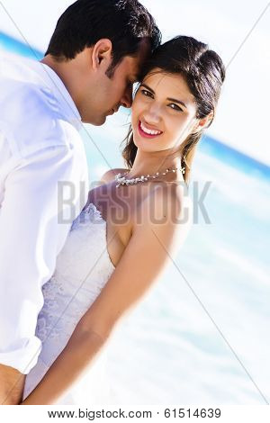 Beautiful couple sharing a romantic moment at the beach