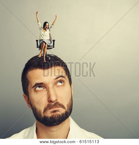 dissatisfied man looking at happy woman over grey background