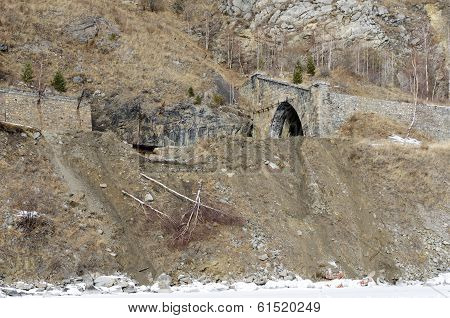 Stone tunnel and fragment of stone wall at the Circum-Baikal Railway's segment