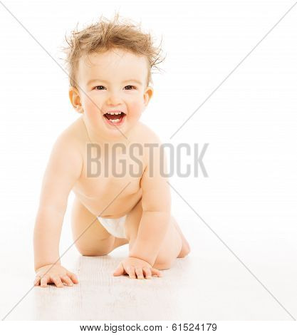 Baby happy smiling with tousled hairs, active boy in diaper crawling over white background
