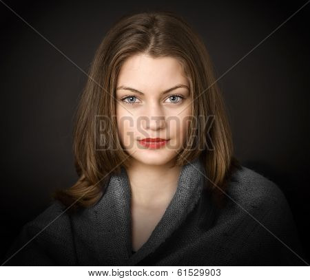Portrait Of A Young Girl With Clean Skin On A Black Background Close-up.