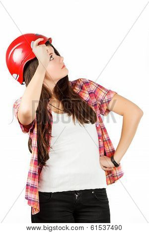 a girl in a red helmet in a shirt in a cell looks up