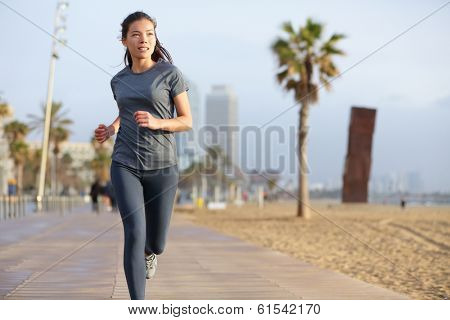 Running woman jogging on Barcelona Beach, Barceloneta. Healthy lifestyle girl runner training outside on boardwalk. Mixed race Asian Caucasian fitness woman working out outdoors in Catalonia, Spain. poster