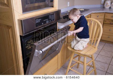 Boy Looking In Oven