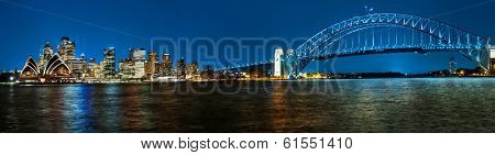 Panoramic photo of Sydney skyline with Harbour Bridge in the evening after sunset