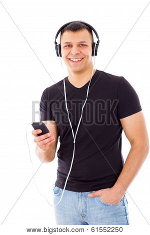 Casual Man With Hand In Pocket Listening To Music On Headphones