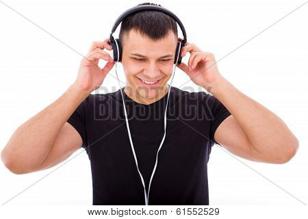 Handsome Boy Listening To Music With Headphones