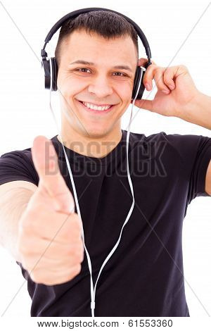 Smiling Handsome Man Listening To Music Showing Thumbs Up