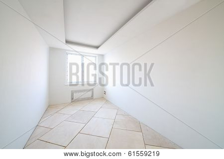 Room with white walls and window in new apartment without finishing