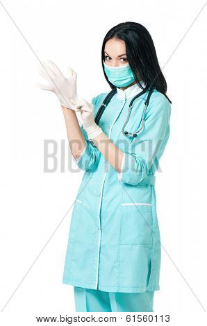 Female surgeon or nurse putting on sterile rubber gloves