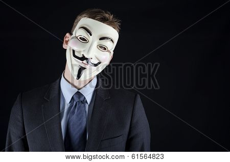 Man in suit wearing vendetta mask