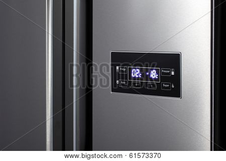 Detail of side-by-side steel refrigerator.