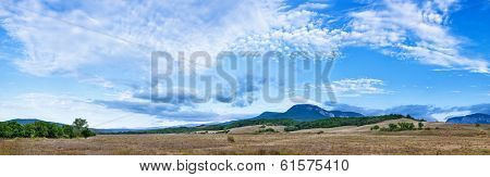 Beautiful landscape panorama with fleecy clouds sky over Belbek canyon in Crimea
