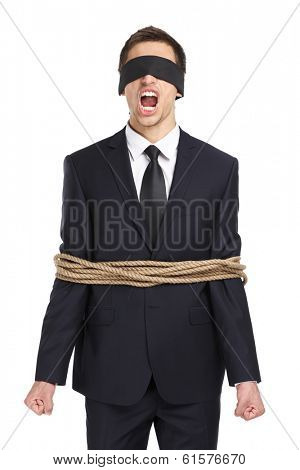 Portrait of blind-folded businessman tied with the rope and screaming, isolated on white. Concept of slavery and violence