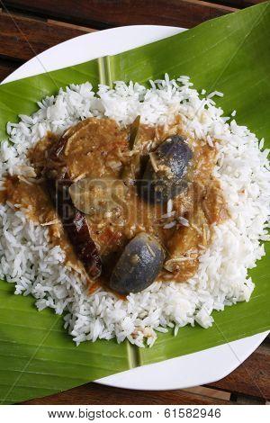 Brinjal sambar with rice on Banana Leaf