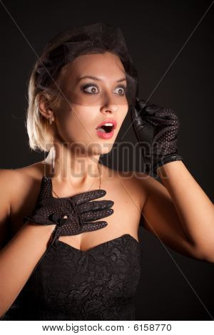 Portrait Of Amazed Retro-style Woman In Black Dress, Veill