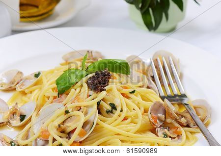Spaghetti with mussels in bowls close up poster