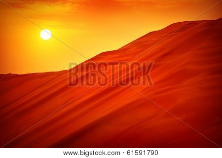 Desert sunset landscape, hot dry wilderness, beautiful panoramic scene, sandy orange hills, extreme travel, heat concept
