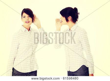 Businesswoman whispering gossip