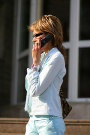 Business Women Walking On The Street And Talking On The Phone