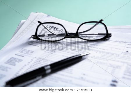 Pile Of Documents And Tax Form
