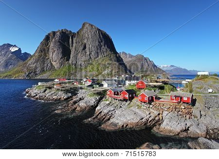 Norwegian Fishing Village With Traditional Red Rorbu Huts, Reine, Lofoten Islands, Norway